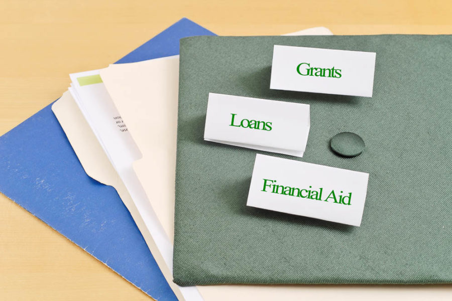 folders on a table with lables that say grants loans and financial aid